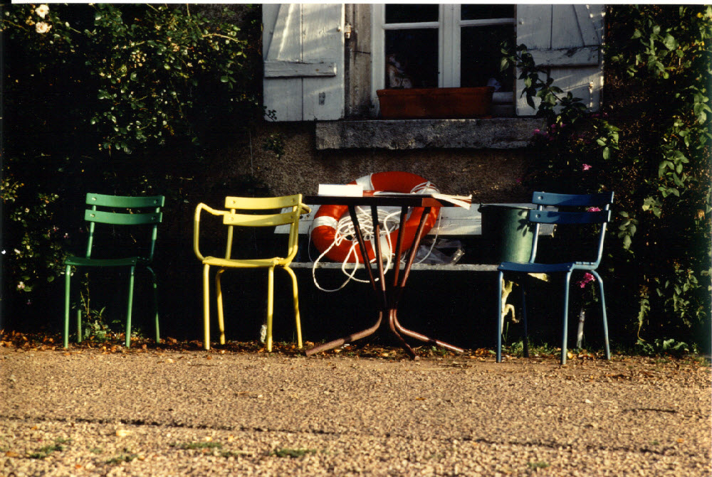Empty chairs by the lock